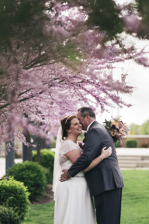 Beautiful bride and groom portrait during spring wedding at Hilton Garden Inn