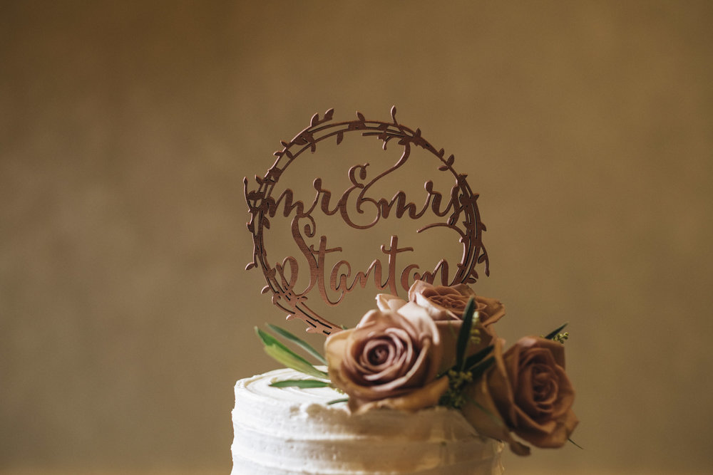 Beautiful cake topper on cake from Jane's Cakes & Confections.