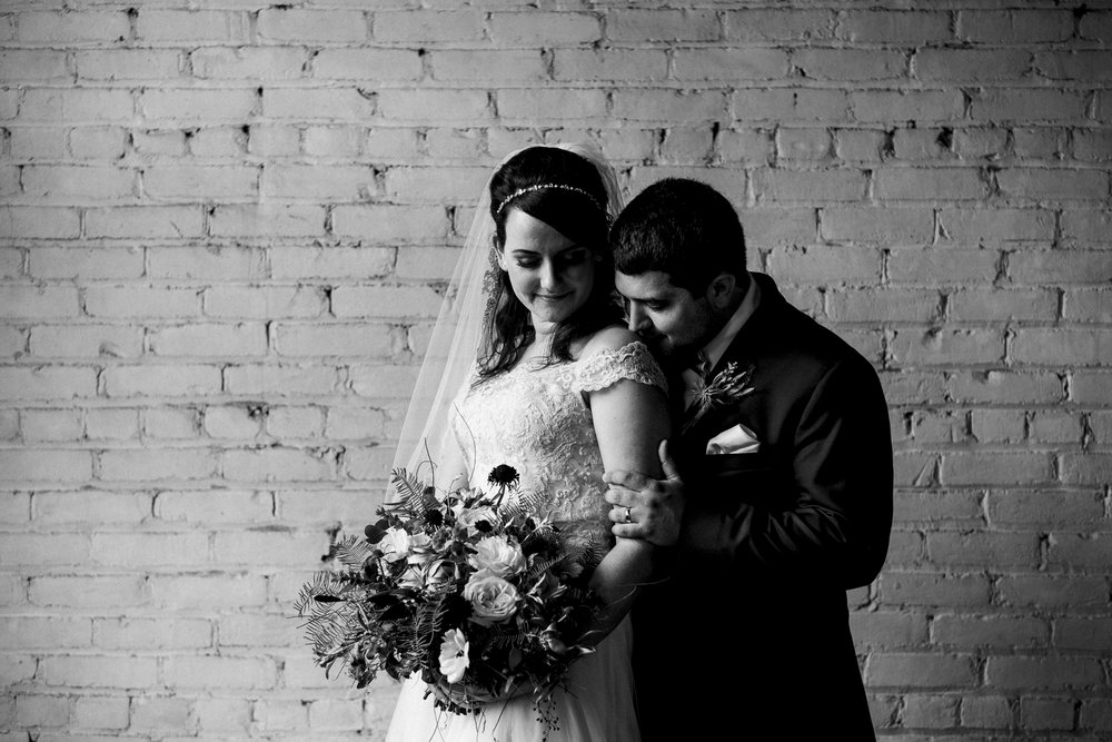Bride and groom photography in downtown Toledo, Ohio at Rustbelt Coffee.