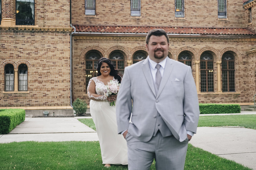 Bride and groom's first look at Nazareth Hall.