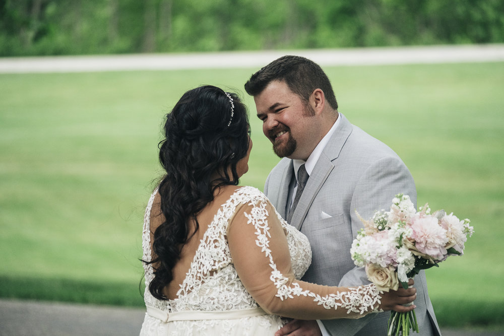 First look between bride and groom at Nazareth Hall wedding.