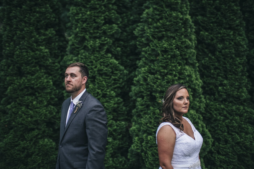 Bride and groom portrait in backyard summer wedding.