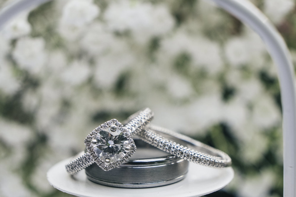 Diamond wedding ring with baby's breath bouquet.