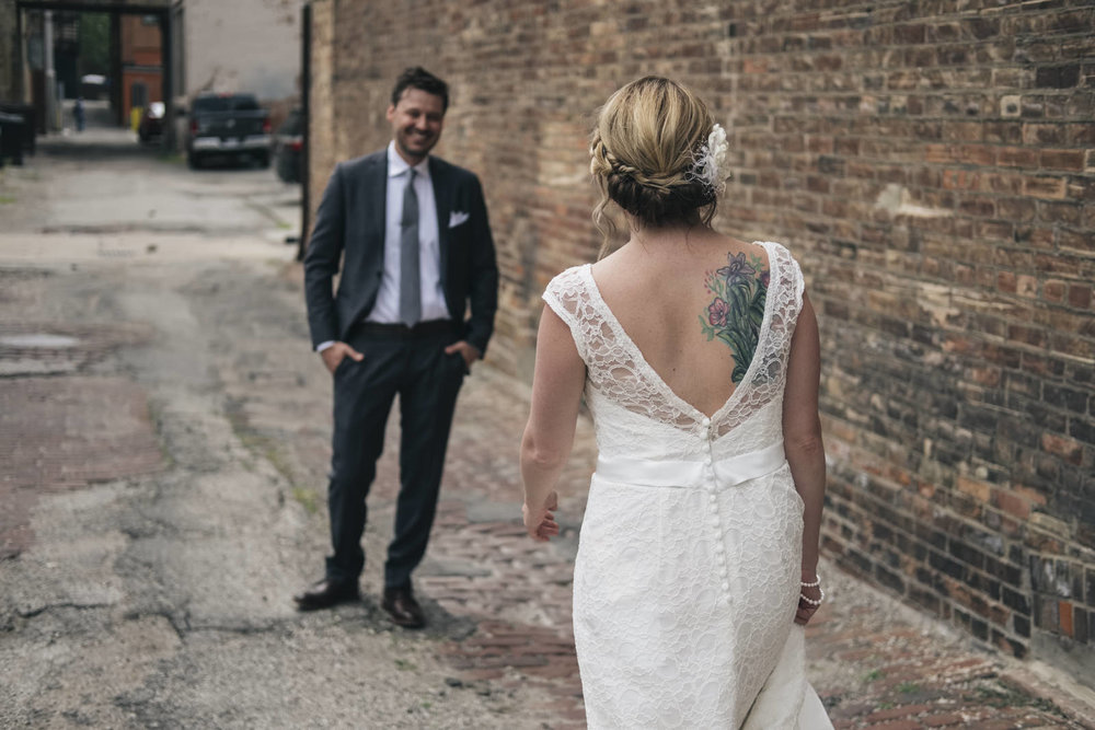 Bride and groom do a first-look before their wedding in downtown Toledo.
