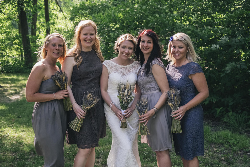 Bride and her bridesmaids pose for a picture on her wedding day in Ohio.