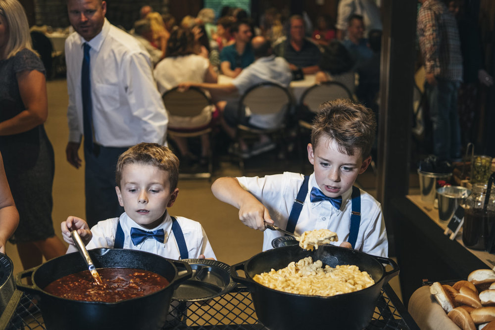 Boys eat during wedding reception in Ohio.