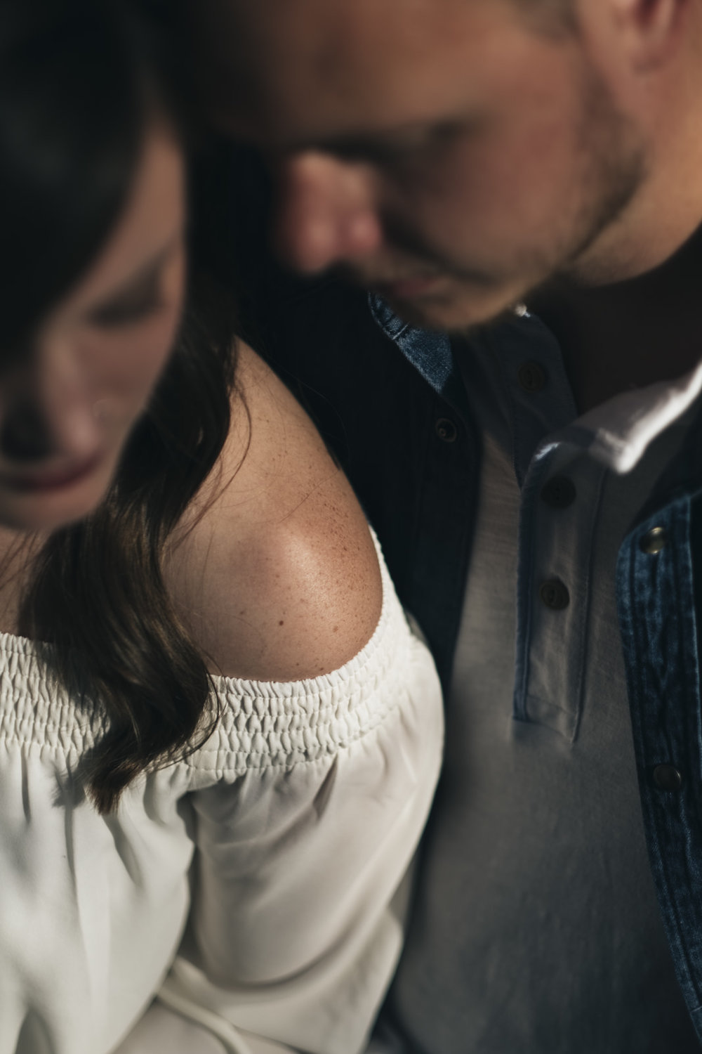 Sweet, intimate portrait of bride and groom to-be at engagement session.