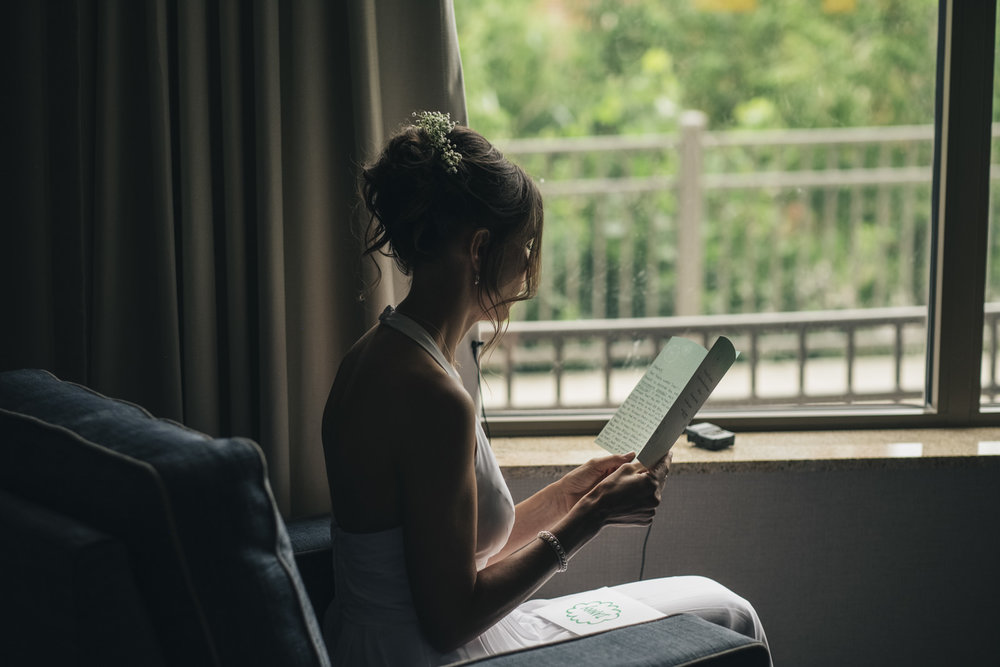 Bride reads a letter from her soon to be husband before their elopement in Toledo, Ohio.