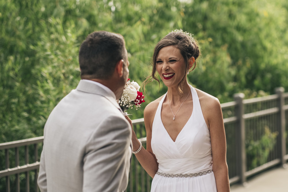 Bride and groom enjoy a first look before their elopement in Toledo.