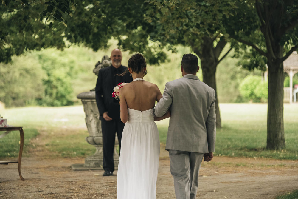 Bride and groom walk down the aisle at their elopement.