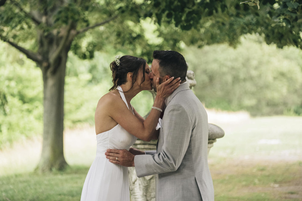 Bride and groom kiss at their elopement.