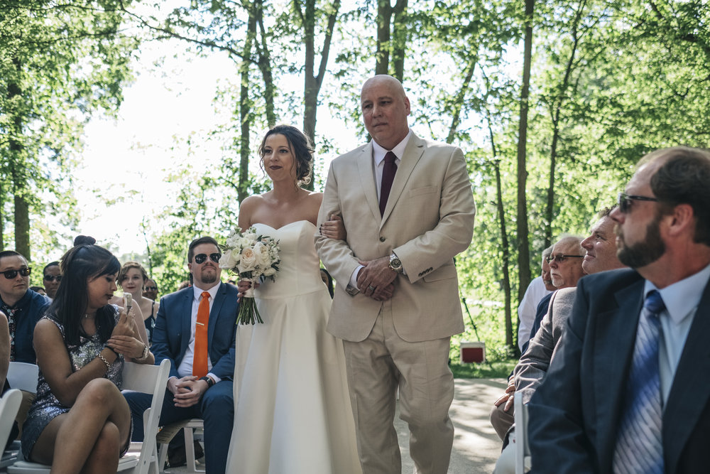 Father walks his daughter down the aisle at her wedding in Grand Rapids, Ohio.