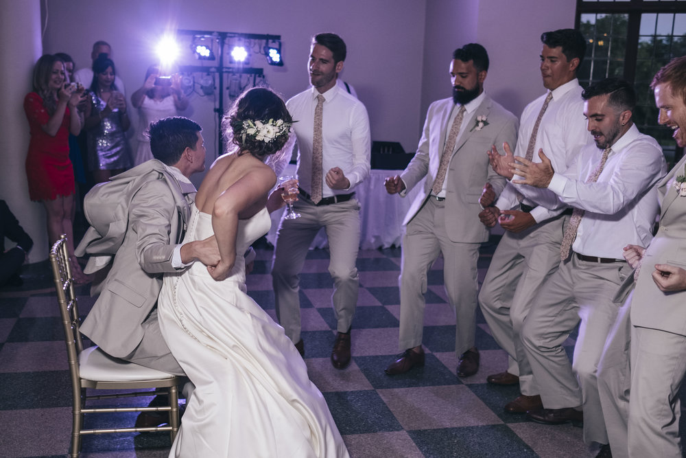 Groomsmen choreographed a wedding reception dance for the bride and groom.