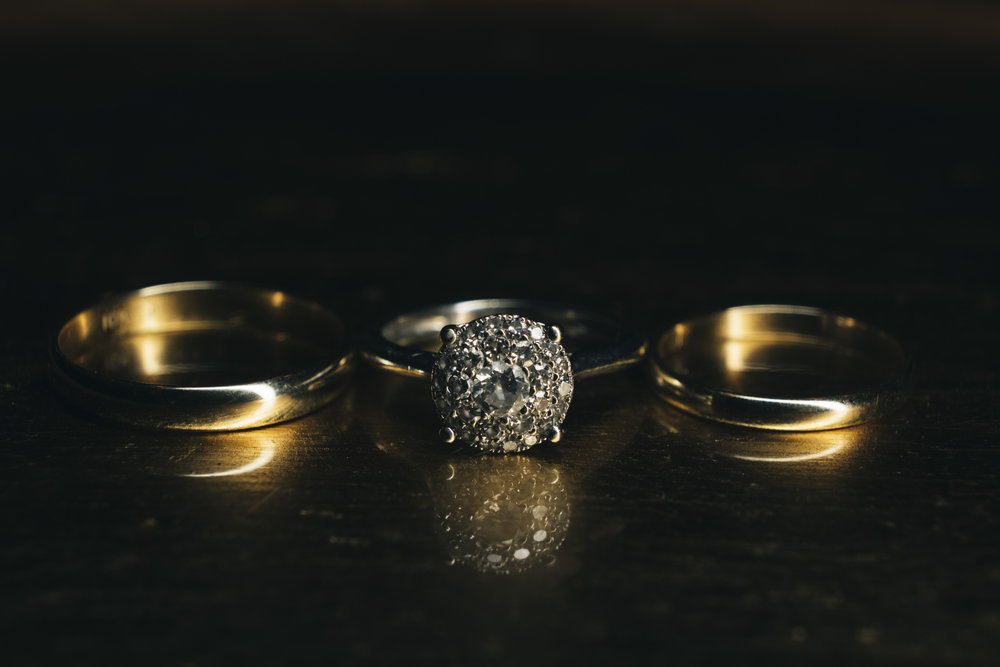 Details of the bride and grooms wedding rings at Nazareth Hall.