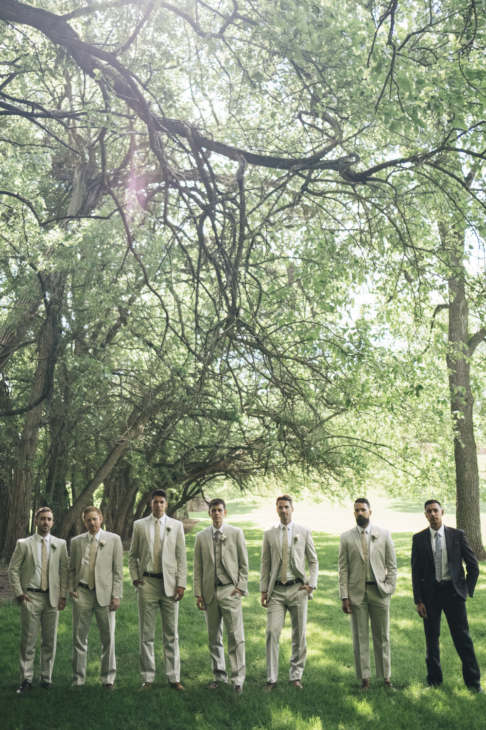 Portrait of the groom and groomsmen before the wedding ceremony at Nazareth Hall.