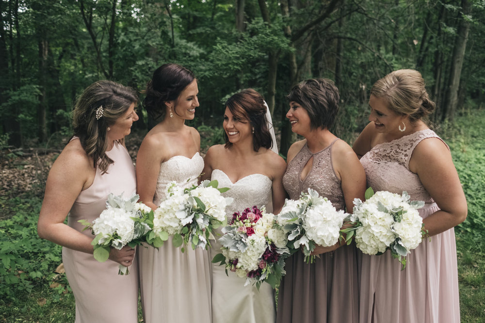 Bridesmaids laughing before the wedding ceremony at Swan Creek Park in Toledo.