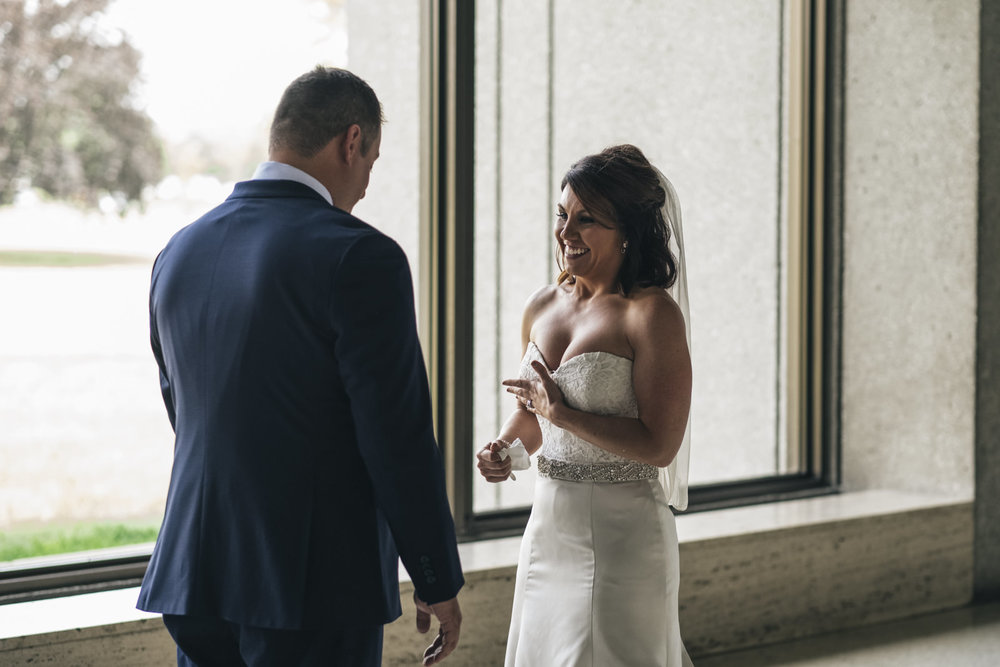 Bride and groom see each other for the first time before their wedding ceremony.