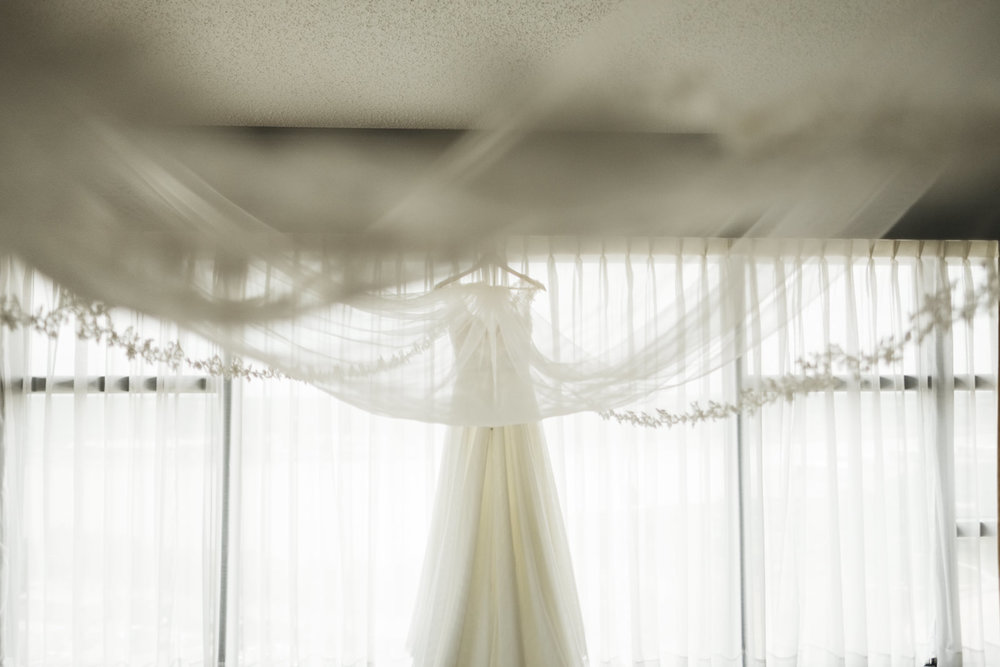 Detail photography of wedding gown with cathedral veil.