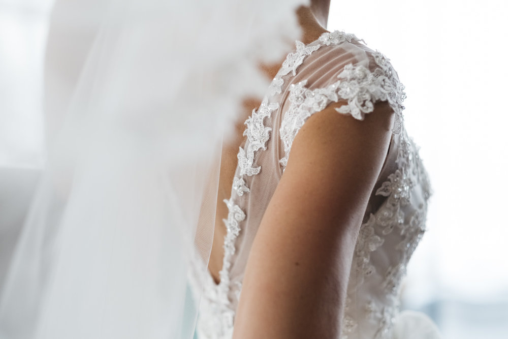 Details of lace wedding dress from Atlas Bridal in Toledo.