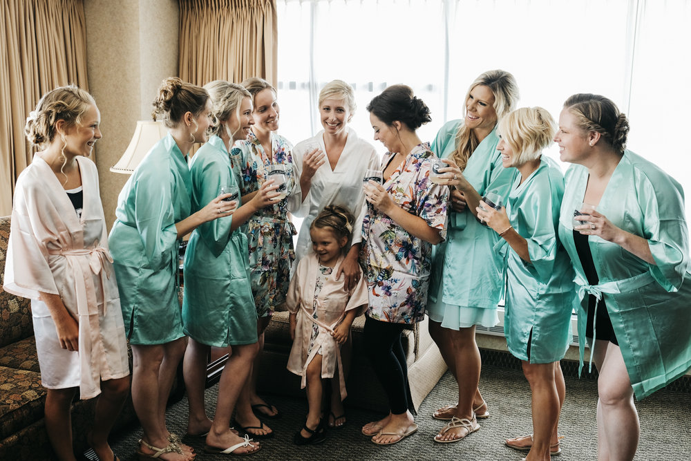 Bride and bridesmaids in cute robes getting ready at Park Inn, Downtown Toledo.
