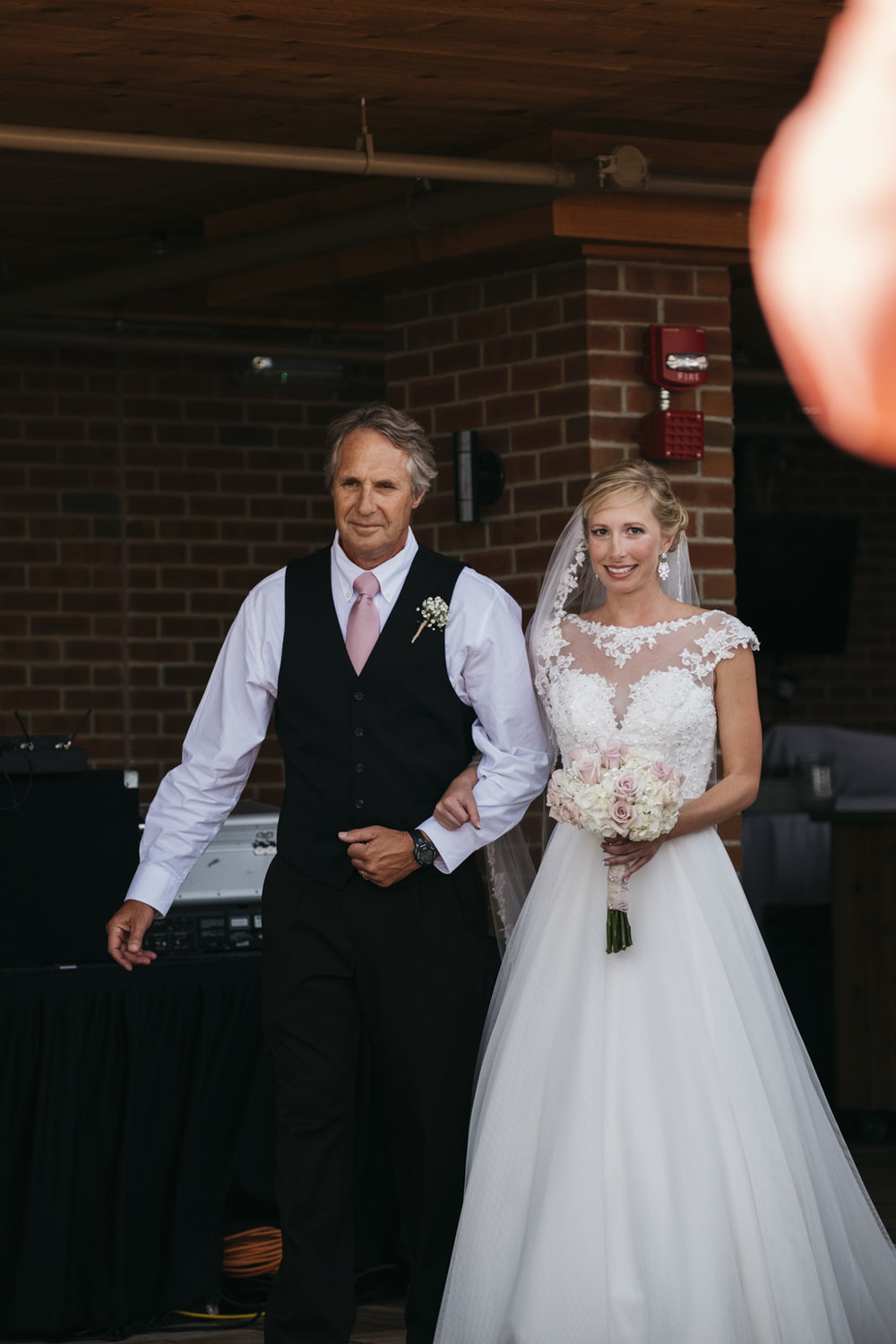 Father walks his daughter down the aisle at wedding ceremony in Ohio.