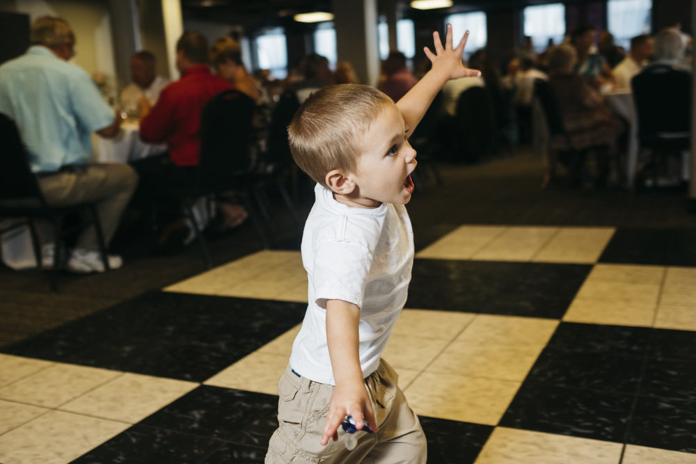 Little boy dances at wedding reception in Toledo, Ohio.