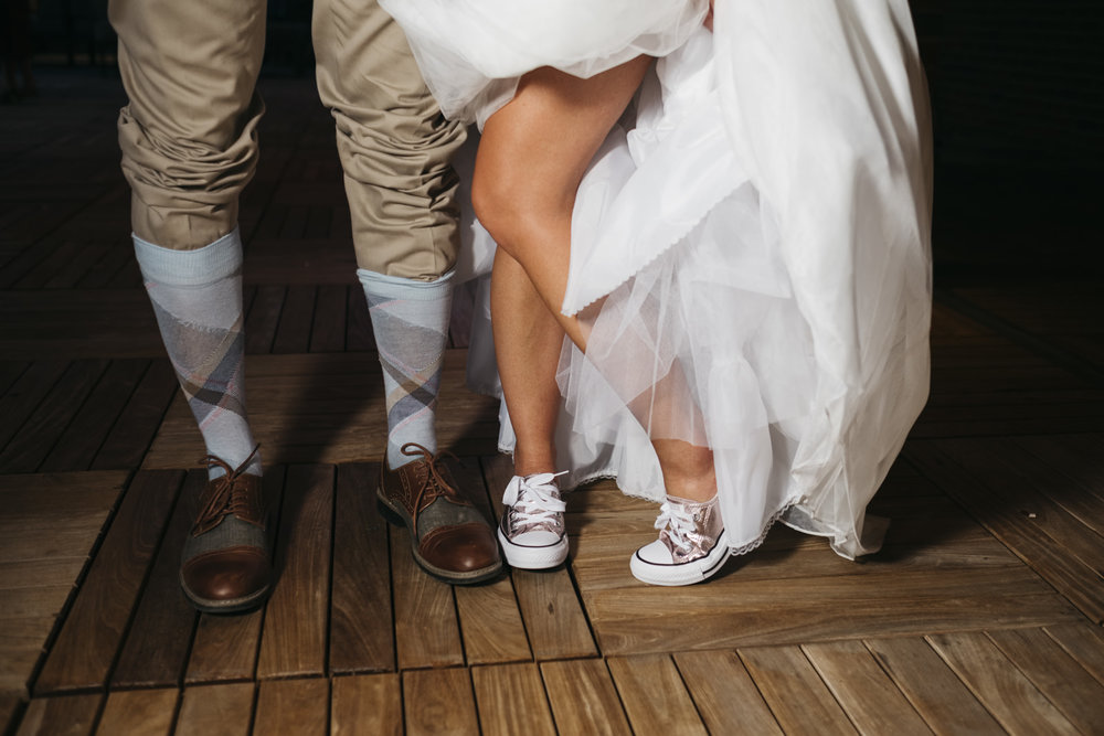 Bride and groom dancing shoes and socks.