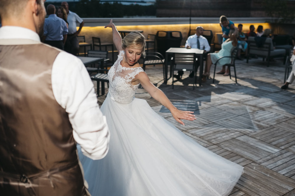 Bride dancing on the rooftop at her wedding reception.