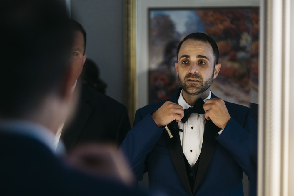 Groom gets ready for his Toledo Country Club wedding ceremony.