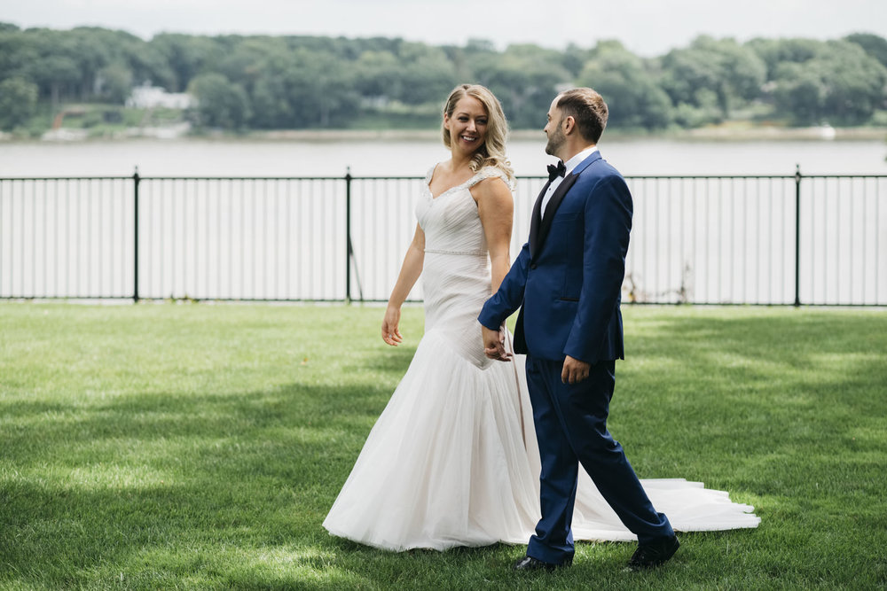 Bride and groom in front of Maumee River at Toledo Country Club Wedding.