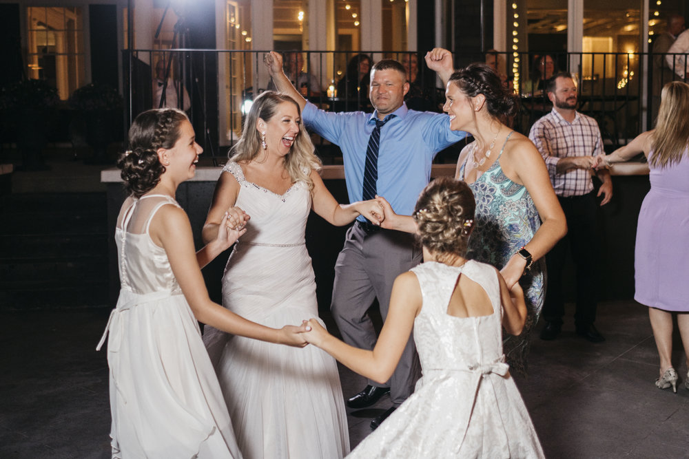 Bride dancing with guests at Toledo Country Club.