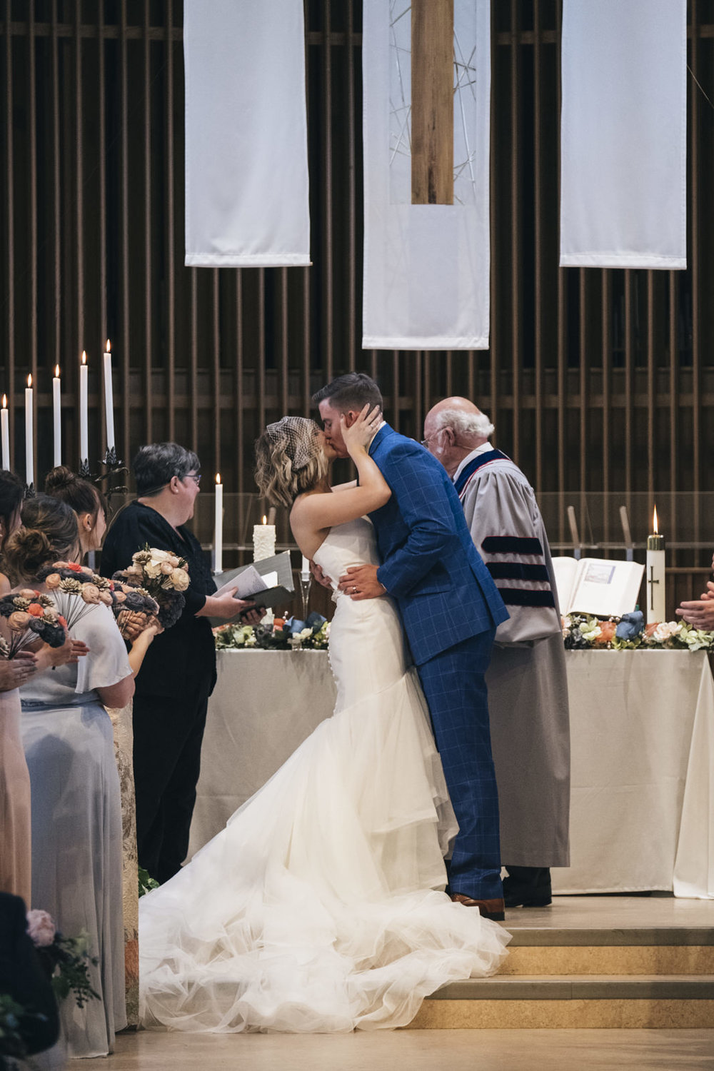 First kiss between bride and groom.