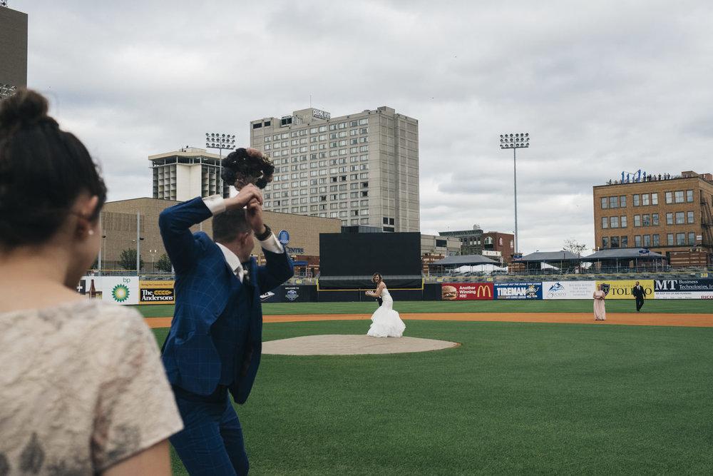 Bride bats to husband on wedding day at Toledo Mudhen's Stadium.