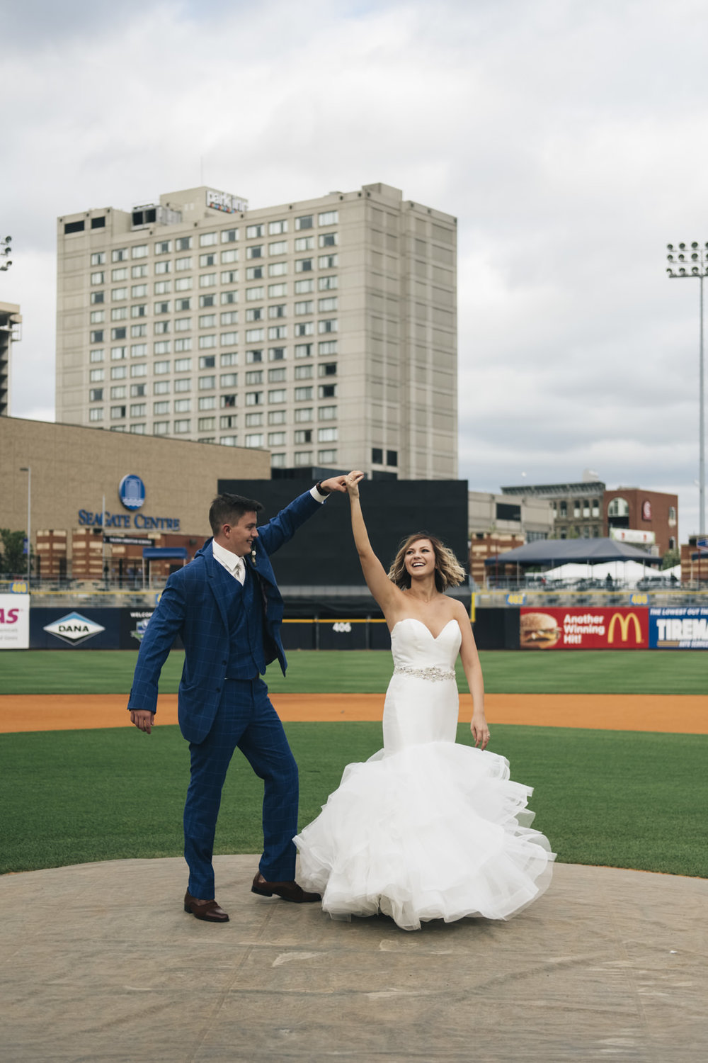 Bride and groom wedding photography in the Toledo Mudhens Stadium.