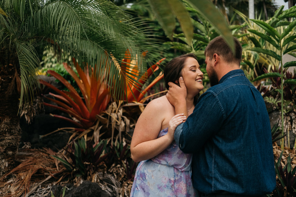 Bride and groom lean in for a kiss before their wedding ceremony last November in Hawaii.
