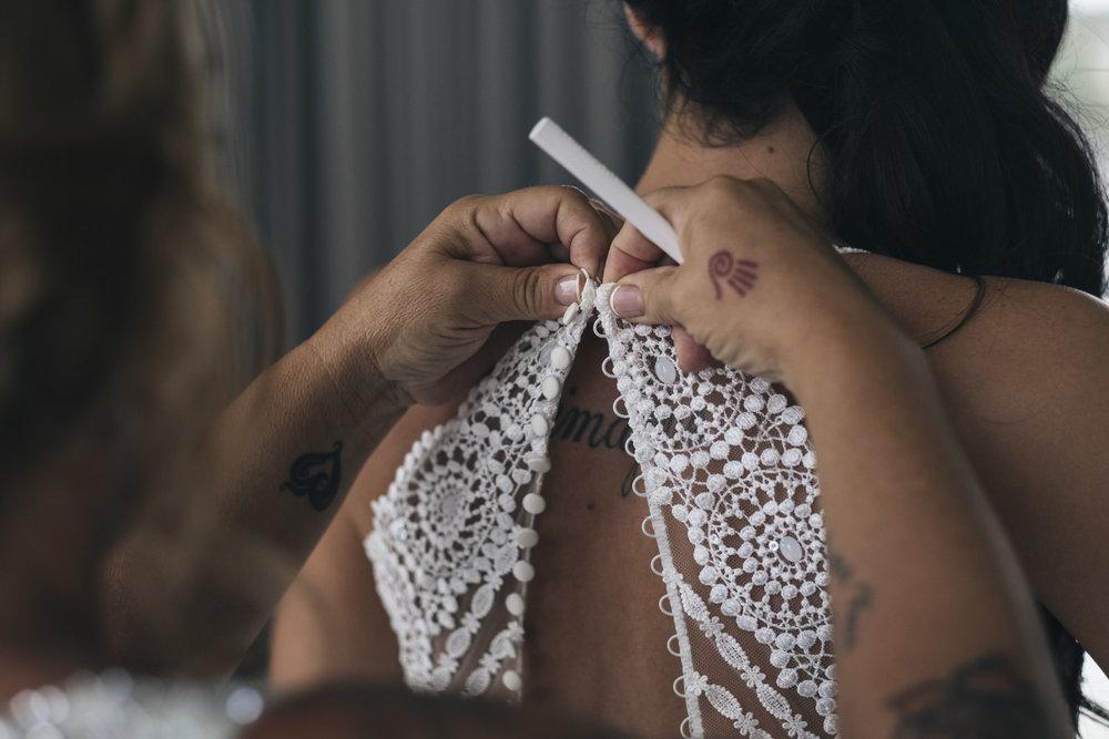 Bride getting in wedding dress from Atlas Bridal in Toledo, Ohio.