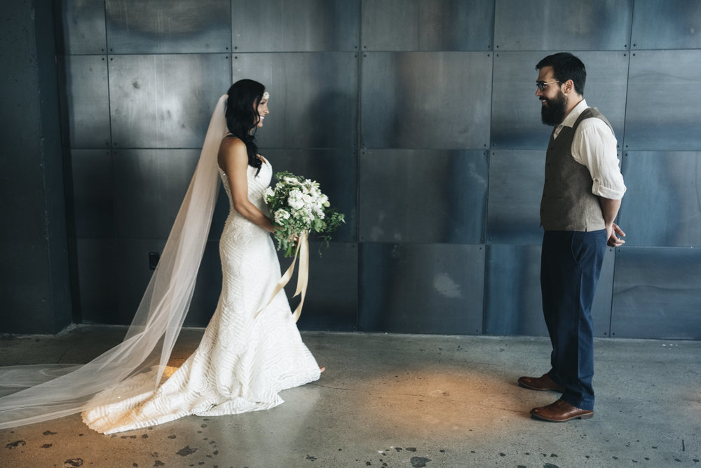 Bride and groom do a first look at The Heights in the Renaissance Hotel Toledo.