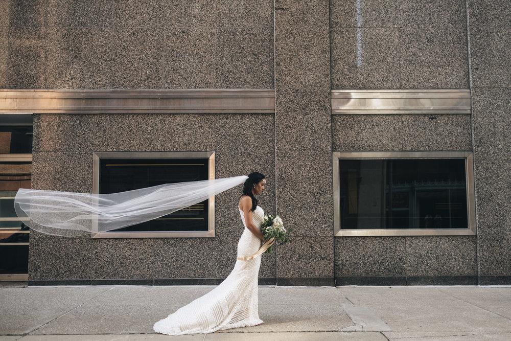 Bride with beautiful wedding veil in downtown Toledo, Ohio.