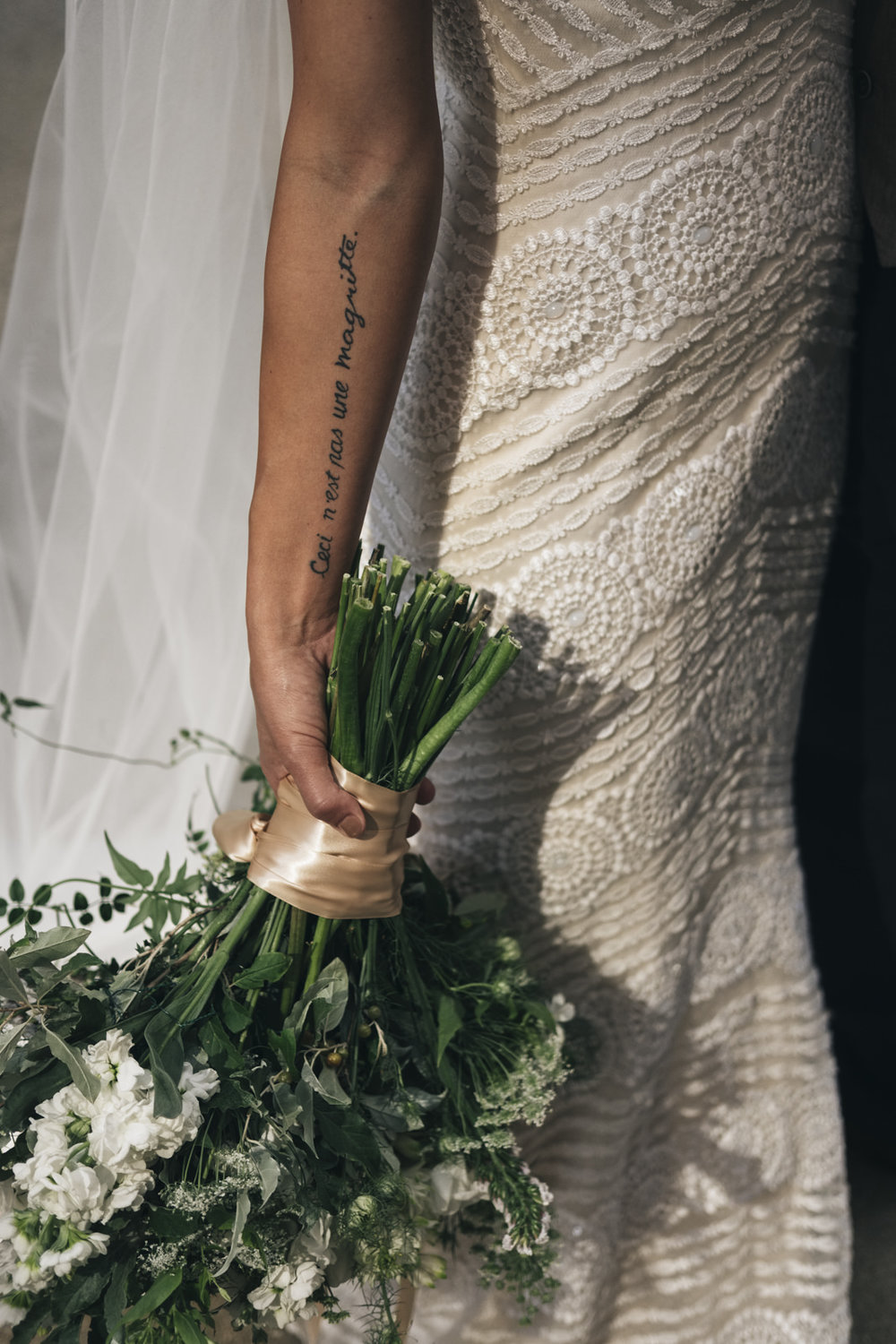 Beautiful quote tattoo on bride.