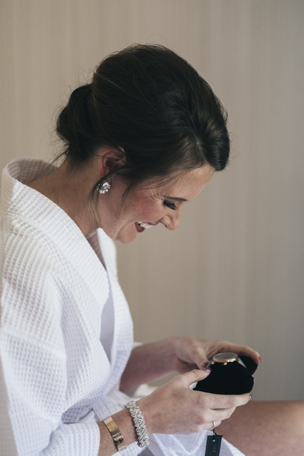Chris received a watch from LeeAnn and opens the gift before her wedding ceremony.