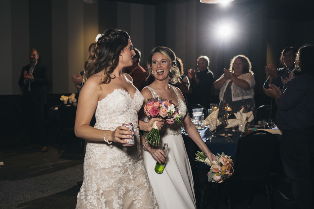 Brides enter their reception at The Premier in Toledo, Ohio.