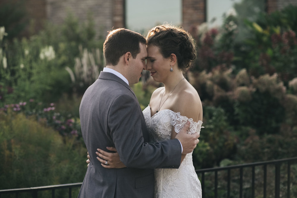 Bride and groom go forehead to forehead for their creative session after the wedding ceremony.