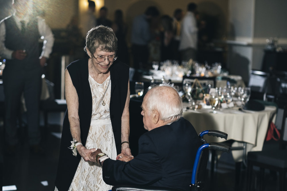 Cute couple dances at a wedding reception at the Toledo Zoo in Ohio