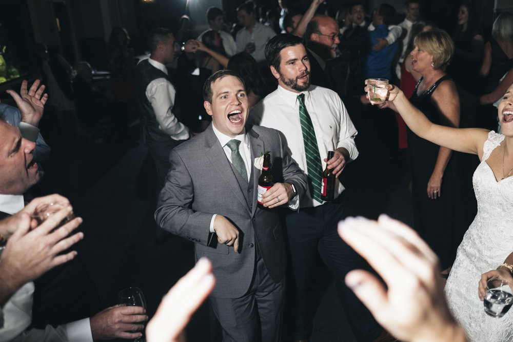 Wedding reception at Toledo Zoo in northwest Ohio shows people dancing and having fun