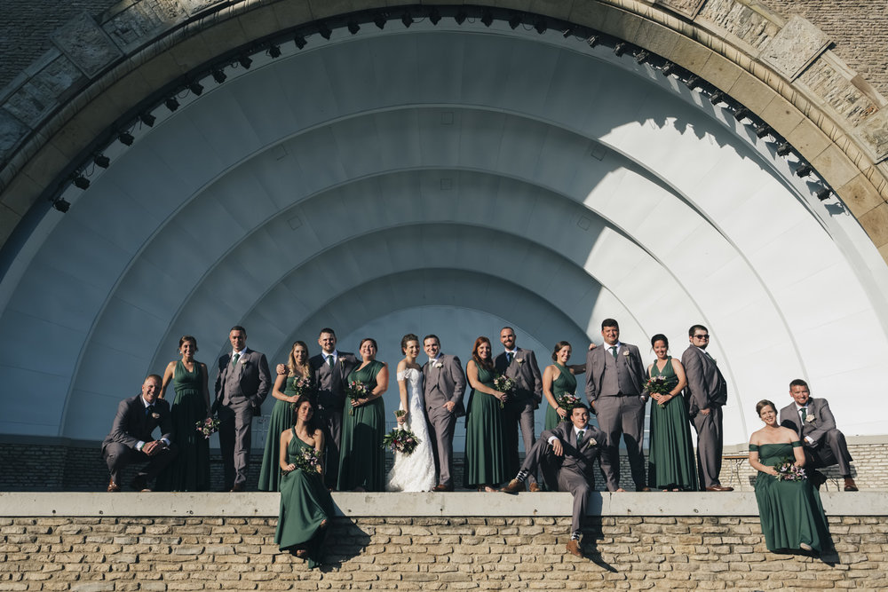 Bridal party takes picture with the bride and groom in this unique amphitheater picture.