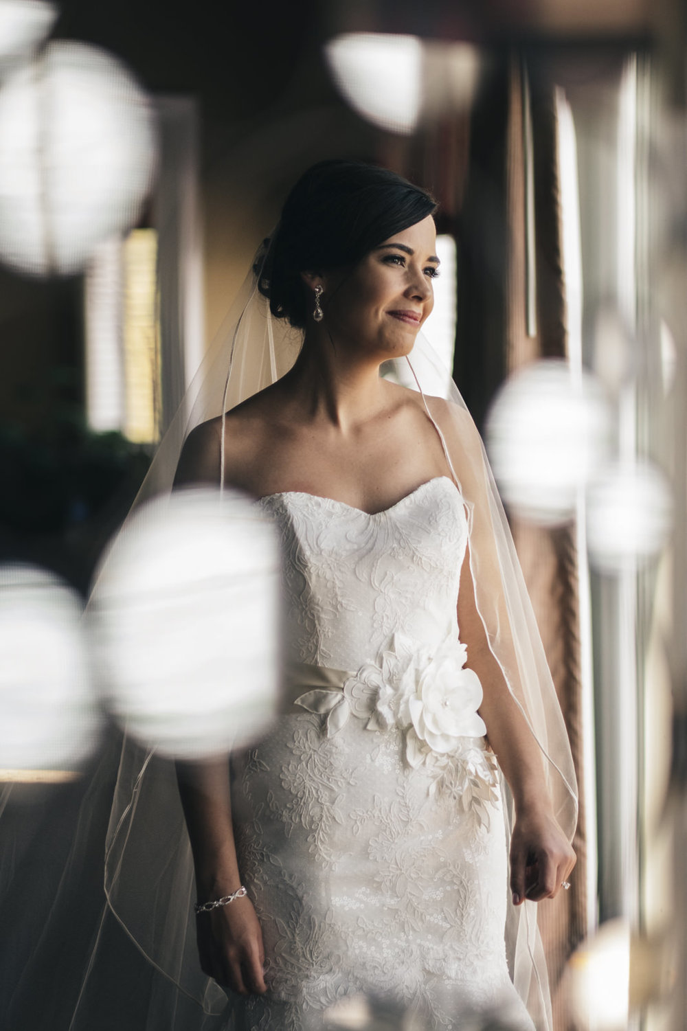 Bride stands in her dress inside of her home near lake Erie in Marblehead, Ohio