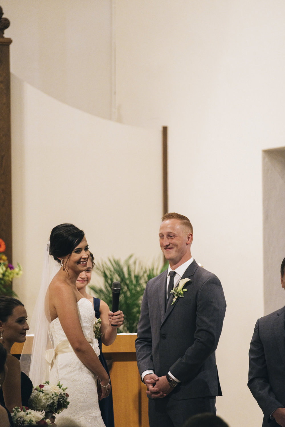 Bride and groom smile and laugh during their wedding ceremony in northern Ohio.