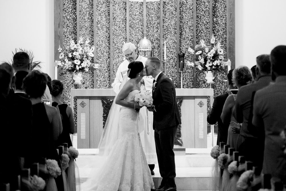 Bride and groom kiss for the first time as husband and wife