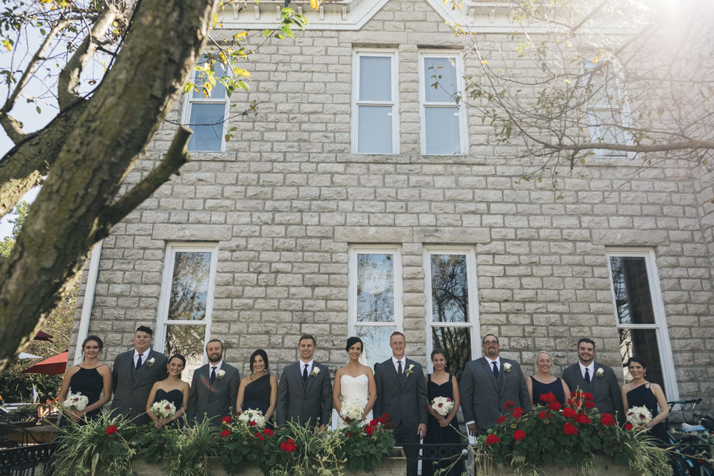 Bridal party stands outside for a picture near a Lake Erie after wedding ceremony