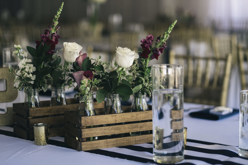 Roses sit on a table for a nautical themed wedding in Marblehead, Ohio.